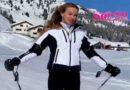 Taylor Mega sugli sci in montagna ... Tra le curve